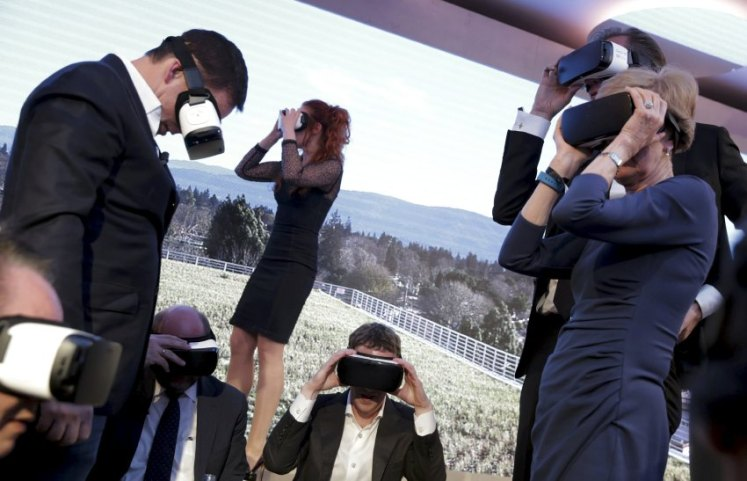 Facebook CEO Zuckerberg and guests use Gear VR virtual reality headsets during the awards ceremony of the newly established Axel Springer Award in Berlin