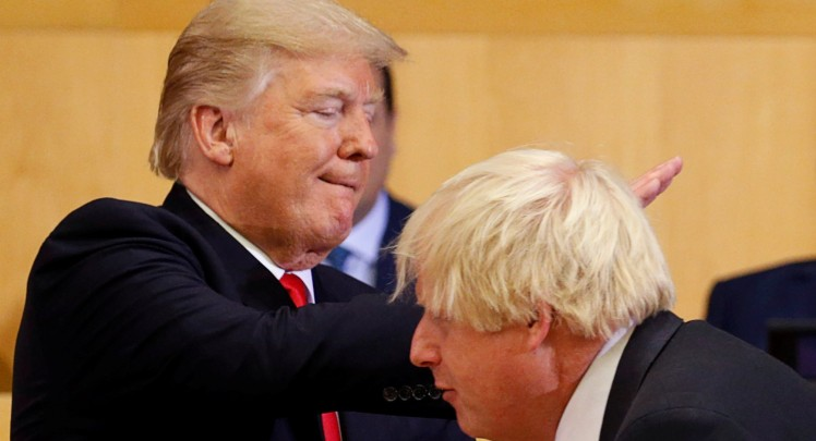 U.S. President Donald Trump pats British Foreign Secretary Boris Johnson on the back as they participate in a session on reforming the United Nations at U.N. Headquarters in New York